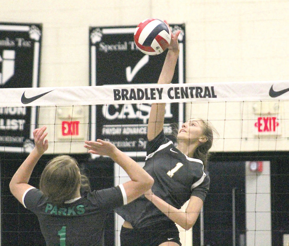 BRADLEY CENTRAL junior Kierstyn Viola (1) blasts one of her eight kills, plus she had three blocks in Monday evening's 3-1 Bearette victory over visiting Rhea County.