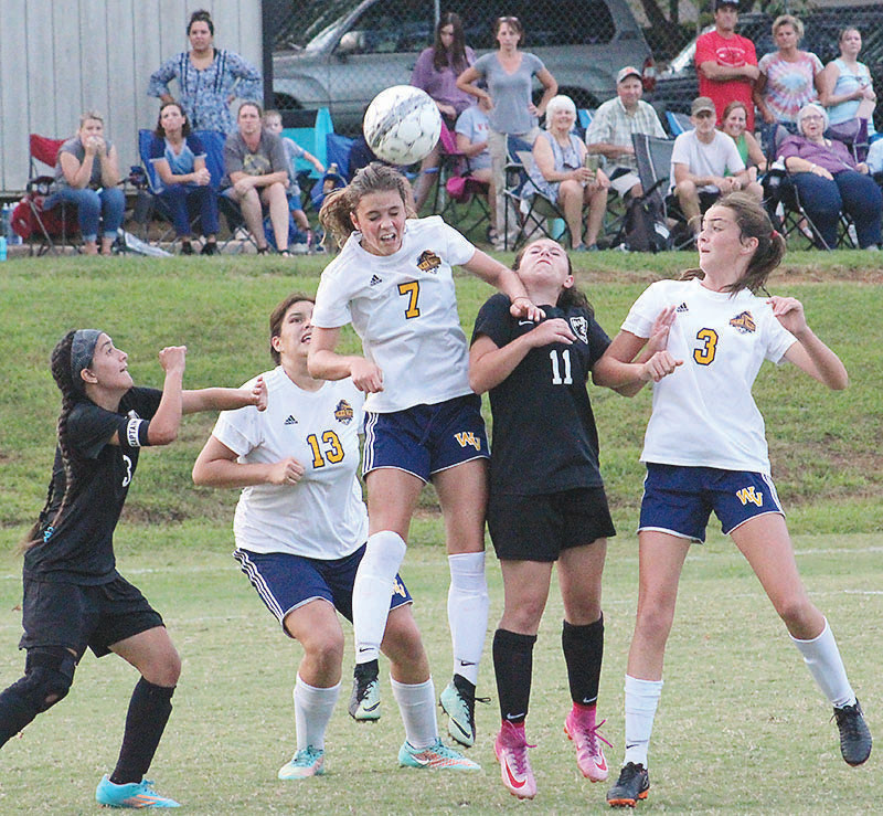 WALKER VALLEY sophomore forward Macy Gibson (7) goes up to head the ball late in the second half against Bradley Central. Gibson's provided the winning edge late with a goal in the 66th minute in a 2-1 road victory Thursday at BCHS.