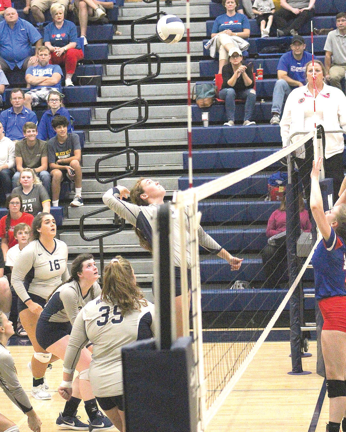 WALKER VALLEY'S Kaylee Hughes eyes the ball as she goes up for a kill attempt against Cleveland in a district 5-3A volleyball matchup Tuesday, at Walker Valley.