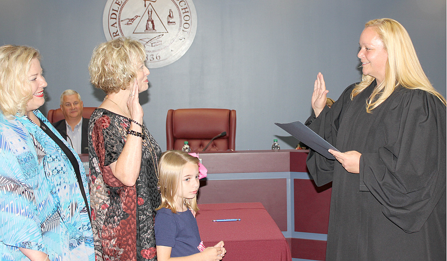 VICKI BEATY, Bradley County Board of Education member for District 2, is joined by daughter Emily Beaty and granddaughter Sophia as she takes the Oath of Office with Magistrate Ashley Gaither.