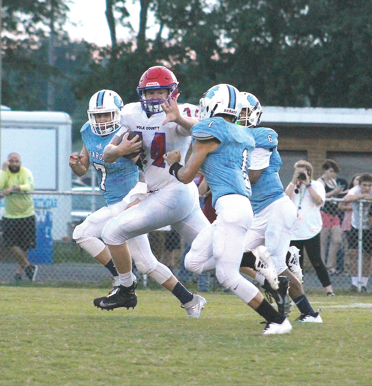 POLK WILDCAT Nate Waters (24) stiff arms a McMinn Central defender for a big gain in Englewood. The Wildcats go on the road Friday to Tellico Plains, for a battle with the Bears.