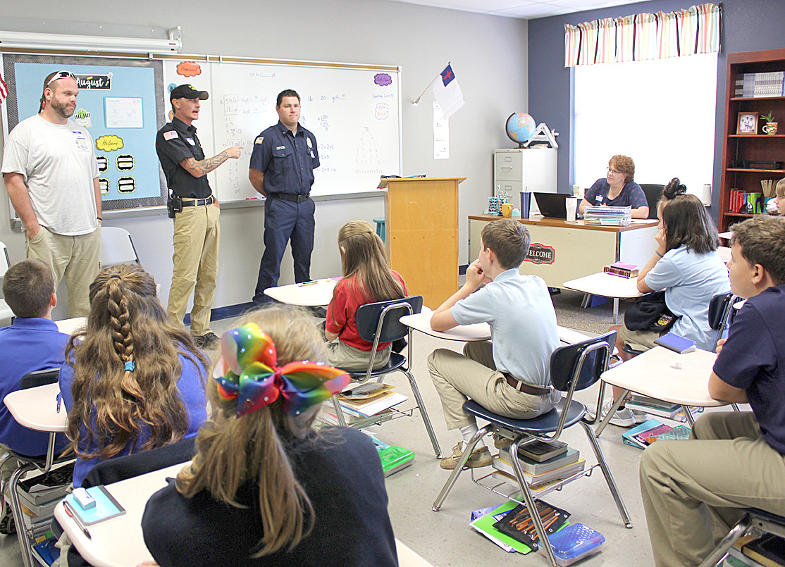 ANSWERING QUESTIONS about their careers, local first responders chat with students during Shenandoah Baptist Academy's First Responders Appreciation Day.