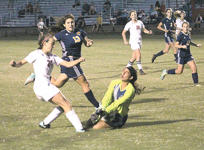 WALKER VALLEY senior goal keeper Miraina Patel dives in front of a shot by a Signal Mountain attacker. The Lady Mustangs started strong, but fell to a state power to begin the Cleveland Classic.