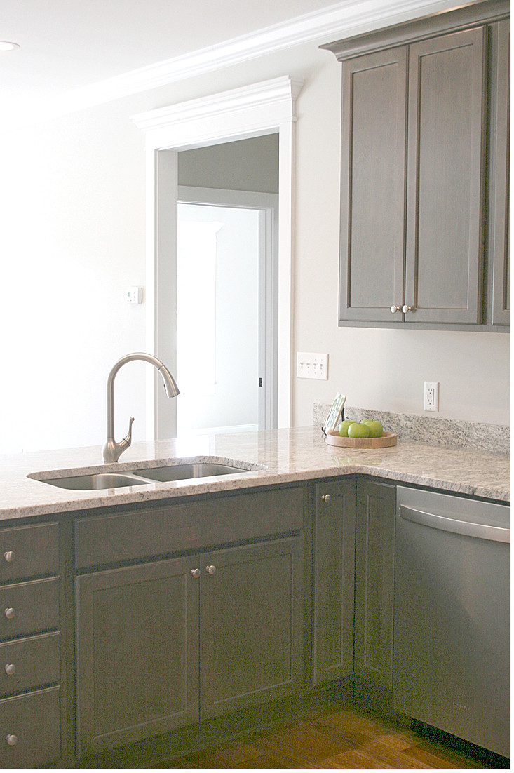 The stainless-steel double sink features a single-handle, high-arc pull-out faucet.