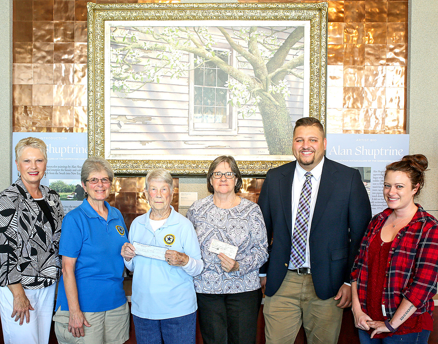 AMERICAN LEGION POST 81 and American Legion Auxiliary Unit 81 members present checks to the Museum Center representatives. The funds will go toward a World War II trunk that will travel around to area schools to educate students about the war and its effects.  From left are Museum Center Executive DirectorJanice Neyman; American Legion Auxillary Unit 81 members Janet Allen and Juanita Cooper; American Legion Post 81 member Mary Baier; curator of education at the Museum Center, Mitch Mizell; and Hope Vollm, AmeriCorps VISTA.