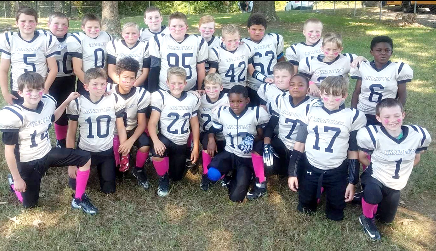 IN SUPPORT of Breast Cancer Awareness Month, the 8 and 9-year-old boys with the Bradley Youth Football team wear pink.