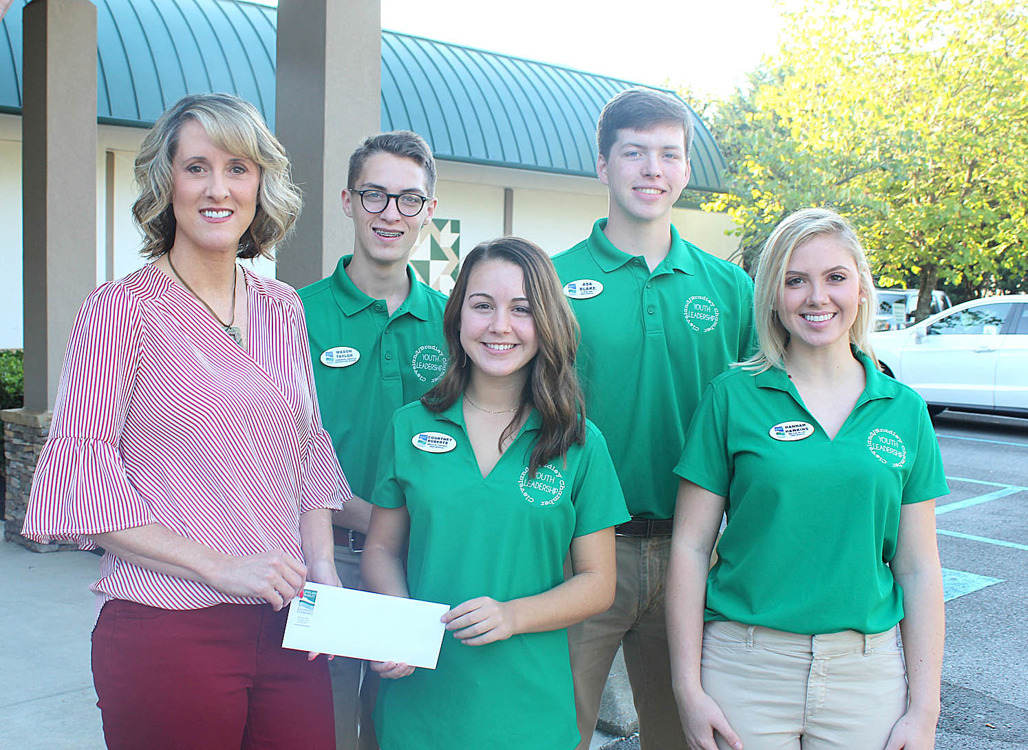 STUDENT LEADERS present a check for $1,408.63 to Tammy Johnson, Habitat for Humanity of Cleveland executive director, as part of their 2018-19 service project. Youth Leader student representatives shown, from left front, are Courtney Rogers, Bradley Central; Hannah Hawkins, Walker Valley; back, Mason Taylor, TCPS; and ASA Blake, Cleveland High School.