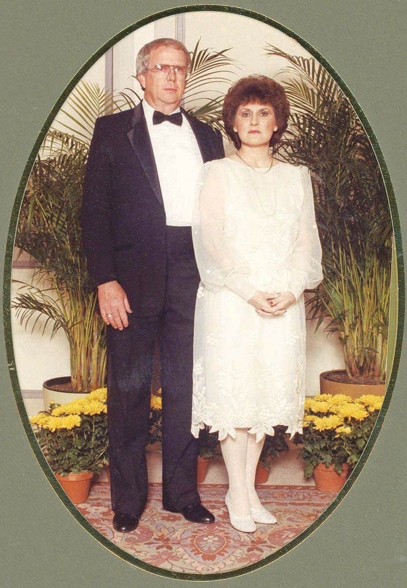 CAROLYN PRUETT, standing with her husband, Edd, was diagnosed with breast cancer at age 38 in 1982. This image was taken several years after her treatment, at a company event for his job.