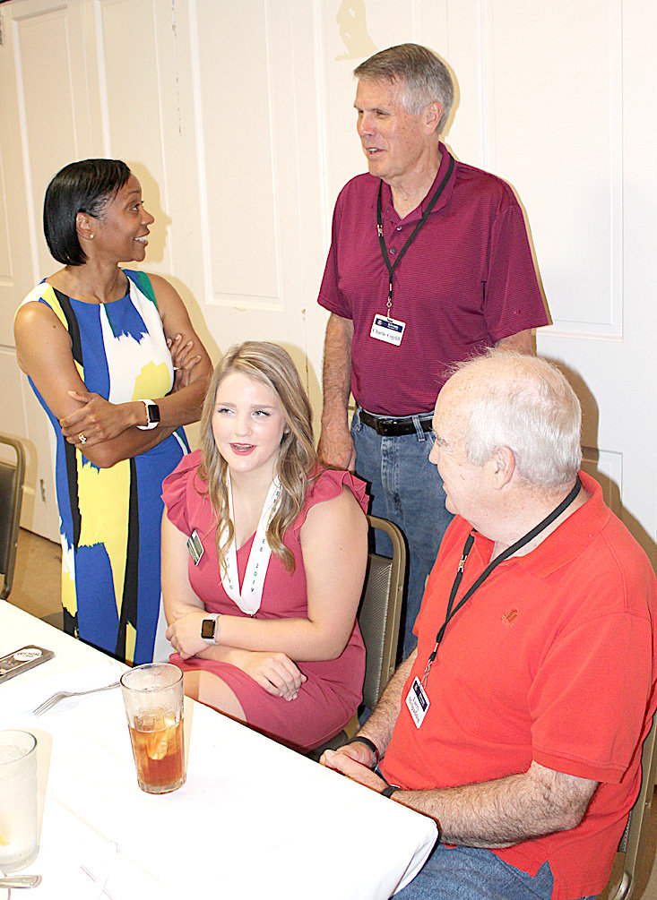 CLEVELAND KIWANIANS Charlie Cogdill, standing at rear, and Larry McSpadden, right,  talk with Tennessee's Distinguished Young Woman Madison Dochety, second from left, and State Program Director Traci Fant. McSpadden has been a volunteer with the state program for several years, and intrroduced Madison to his fellow Kiwanians.