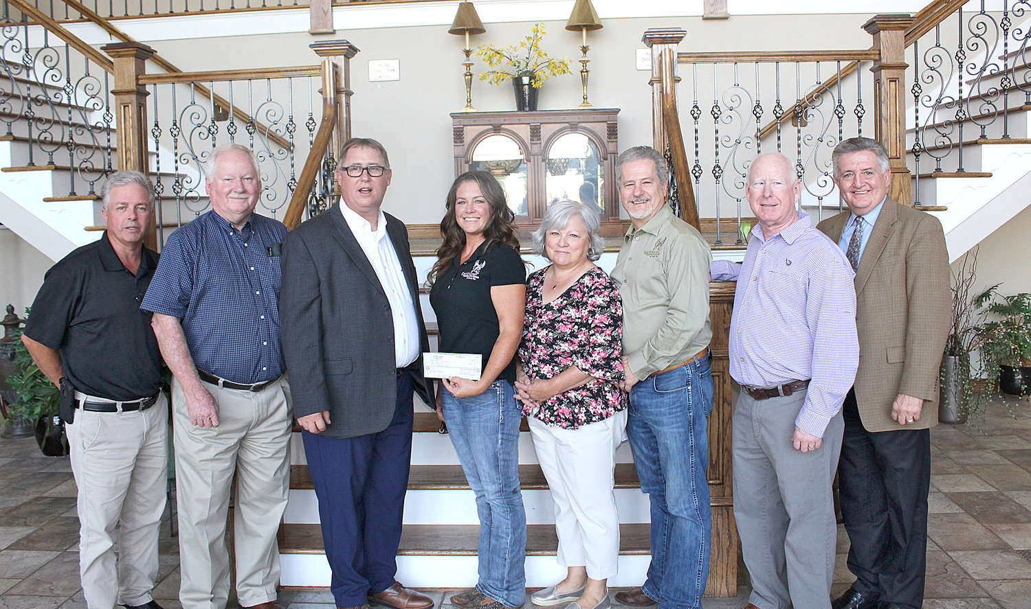 SPIRITHORSE Therapeutic Riding at Black Fox representatives receive a $3,000 donation from Bachman Academy. From left are board members Jeff Gregory, Ken Weller, director Mark Frizzell, SpiritHorse representatives Emily Shelton, Darlene Poteet and Steve Poteet and board members Mike Sikes and Jimmy Dupree.