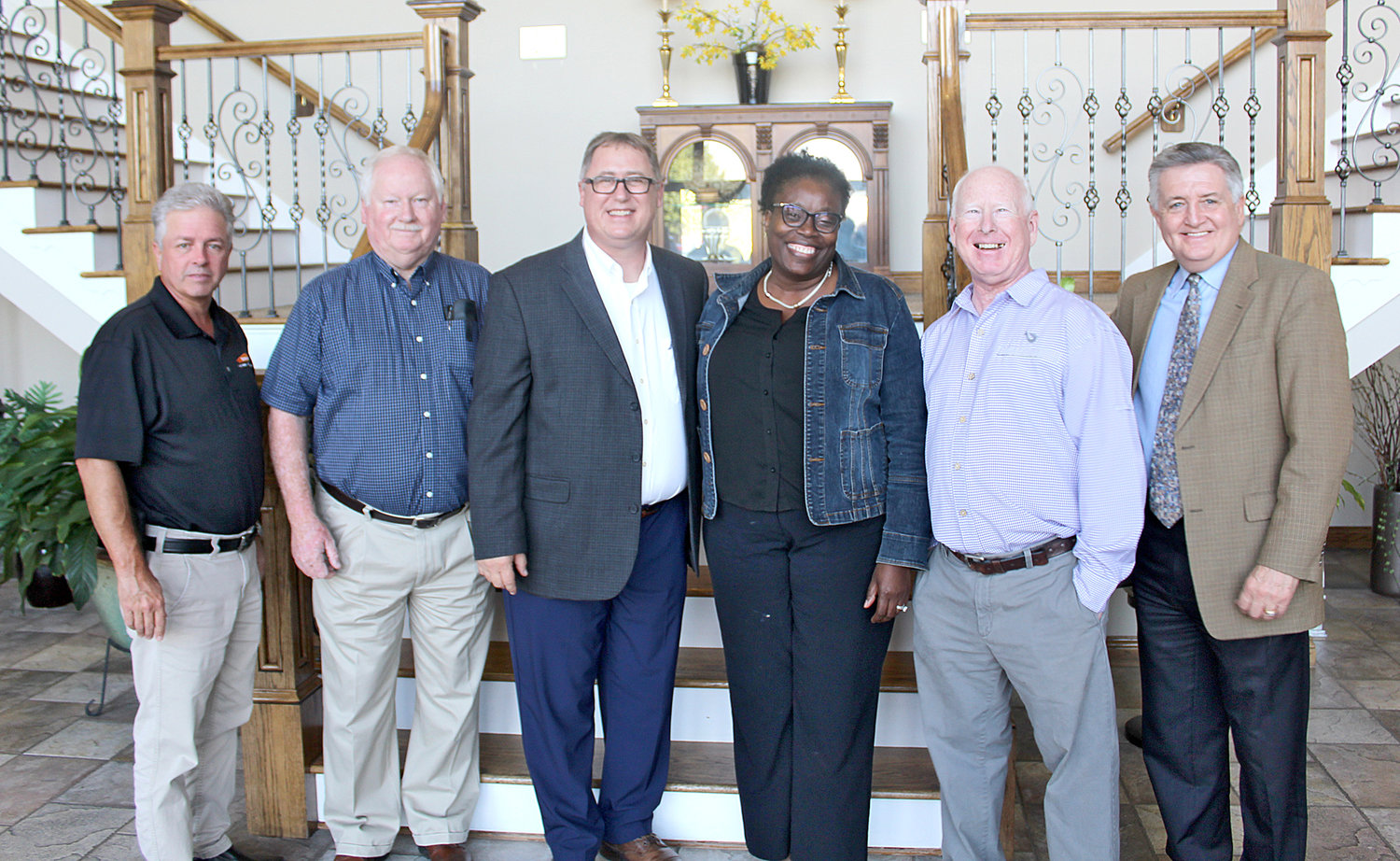 CATHERINE TURKETT, mother of Ola Akanle, accepts a $18,450 donation on behalf of her son, a former Bachman Academy student. He is currently attending a similar school in Boston. From left are board members Jeff Gregory, Ken Weller, director Mark Frizzell, Catherine Turkett and board members Mike Sikes and Jimmy Dupree.