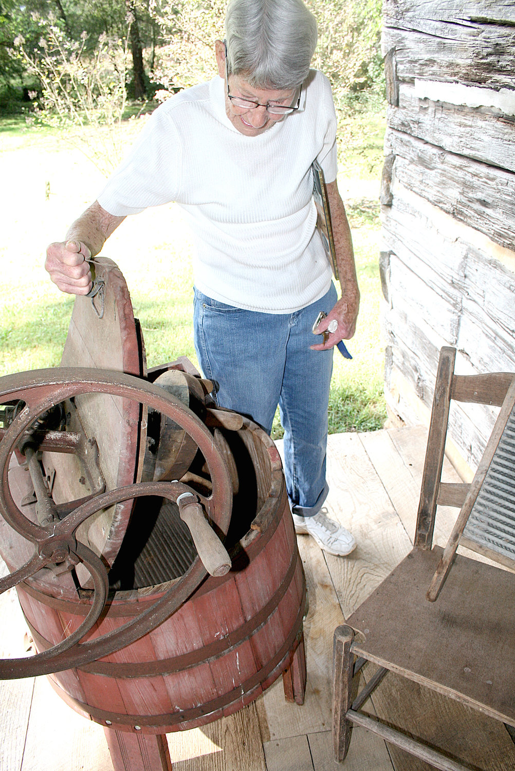 A WOODEN washing machine is one of several items on display at Pioneer Day Open House at the Village at Hawk Creek. Owner Sally Newman states she must fill it with water a few days prior to use in order for the water to swell the wooden planks and prevent leakage during use.