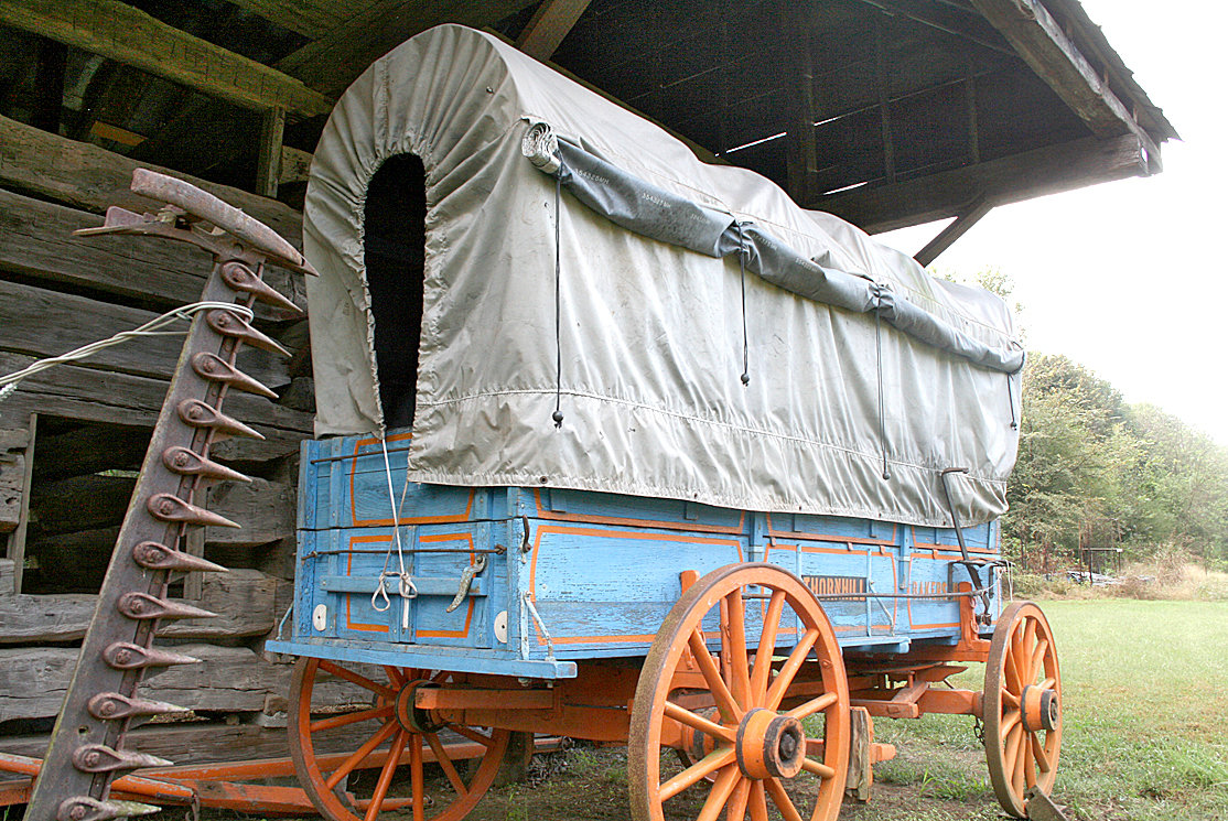 A WAGON is on display at the Village at Hawk Creek and shows attendants the interior and the materials needed to craft such an essential tool of the times.
