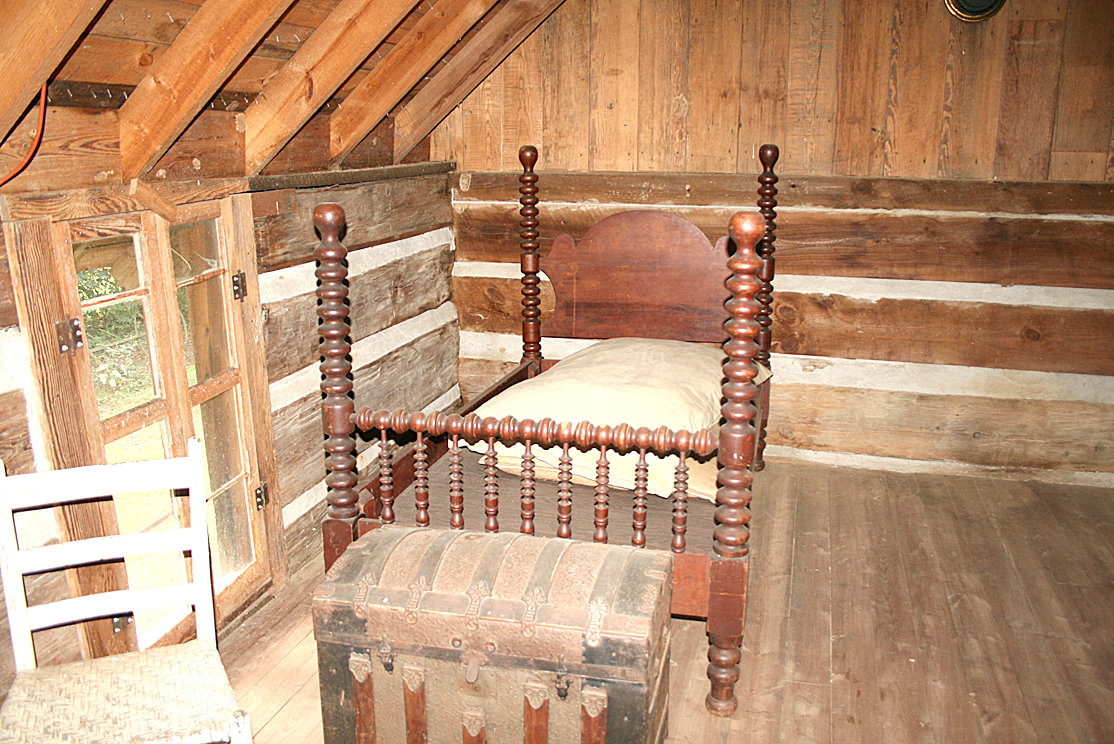 THE UPSTAIRS of the Village at Hawk Creek's halfway house comes with two beds and a chest. The halfway house was modeled after a particular halfway house in Cleveland that was used by copper miners transporting wagonloads of copper on the old copper road. As the trip took longer than one day, the halfway house was the perfect stopover for the night.