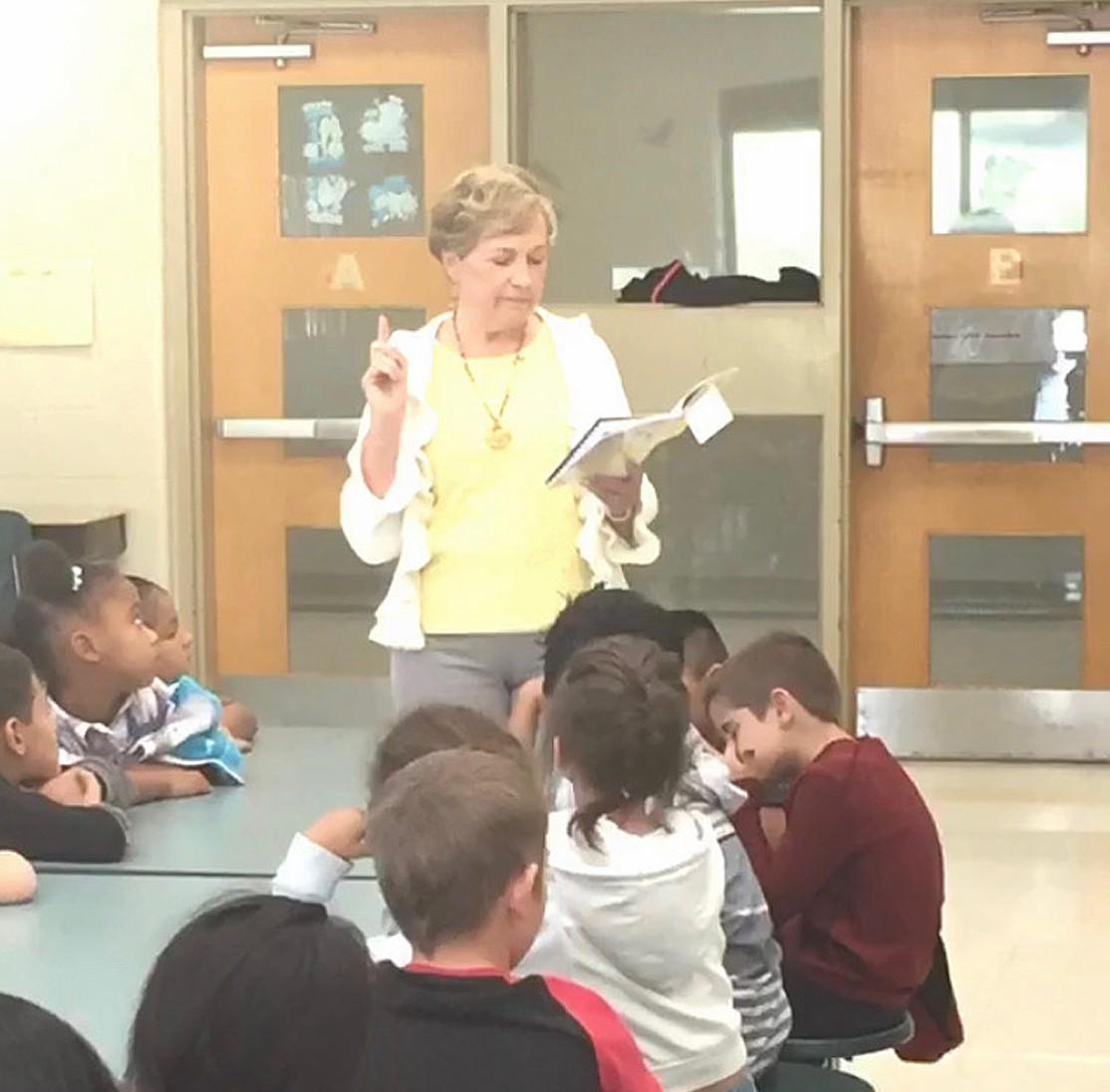 Peggy Pesterfield, CCS board member and Rotarian, reads to first-grade classes at Blythe-Bower Elementary.