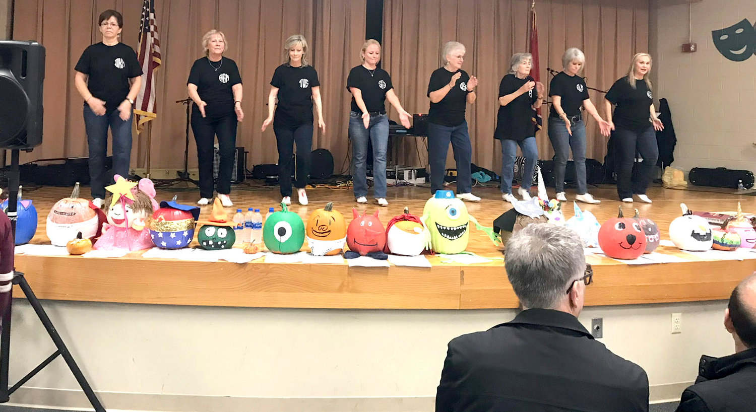 Hilda Griffin and the East Ridge Cloggers (above) provide entertainment at the 2018 Blythe-Bower Elementary Fall Harvest Hoedown. Amusing pumpkin character creations from the festival also adorned the stage. (Below) Cannon Creek Bluegrass Band performs some songs at the event.