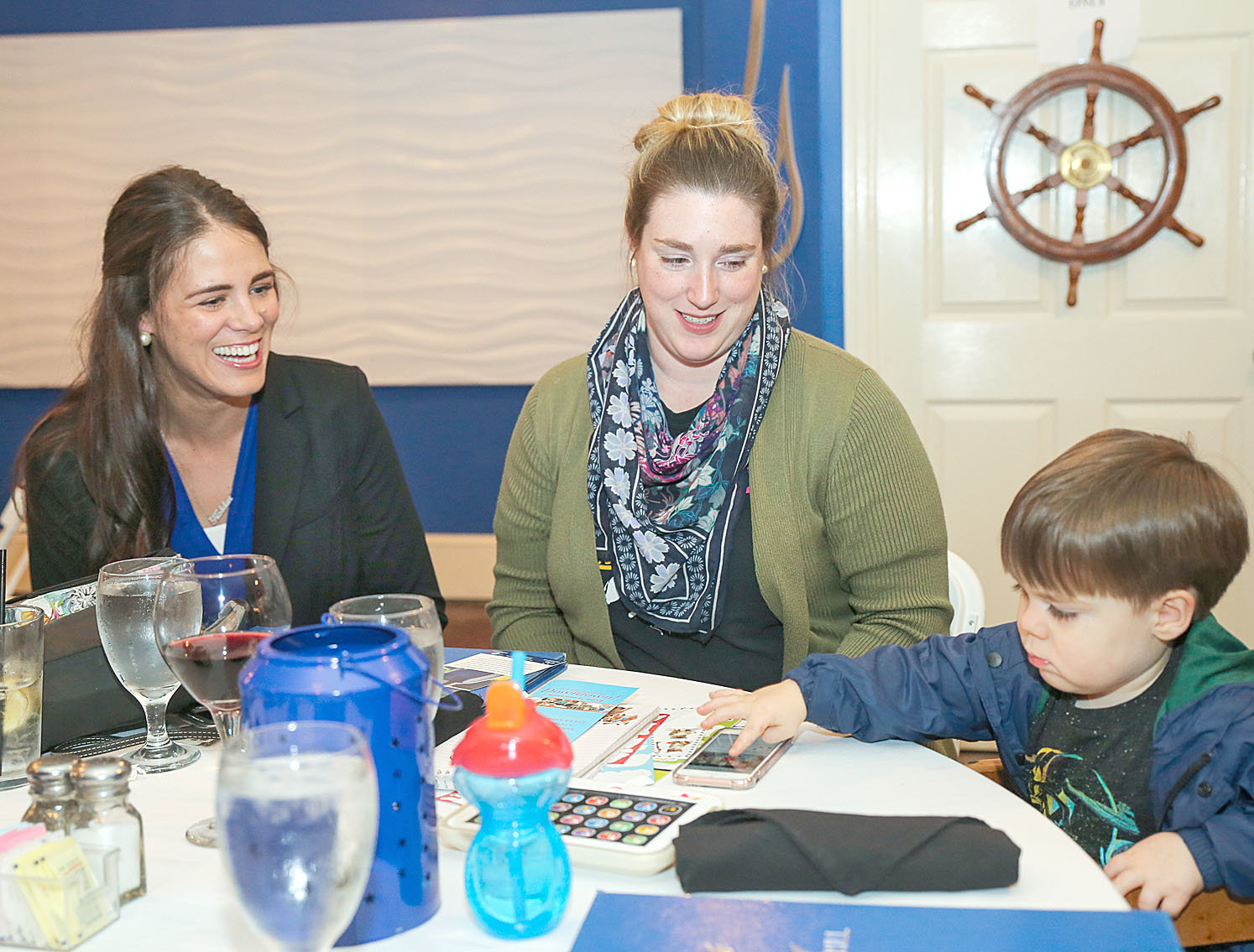MALLORY PICKERT, left, a candidate for theTennessee House of Representatives in District 24, chats with fellow Cleveland teacher Erin LaFever and LeFever's son, Henry Allen, at the Bradley County Democratic Party election night watch party Tuesday at Catch Bar & Grill.