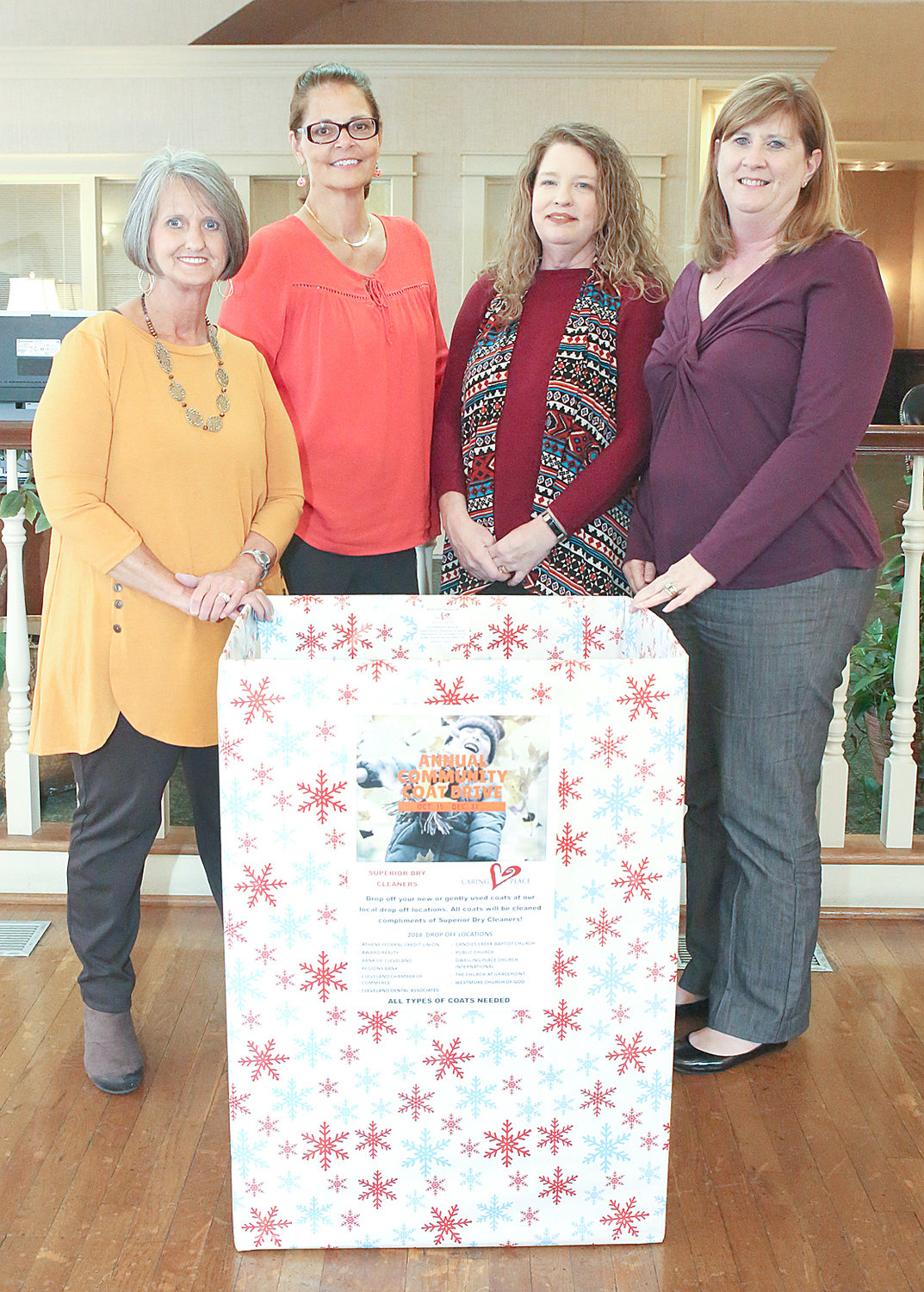COLLECTION BOXES like this one have been placed at local businesses and churches for The Caring Place's annual Community Coat Drive. From left are employees of Bank of Cleveland's downtown location, Becky Kinser, Joan Ownby, Shannon Petersen and Janice Mull.