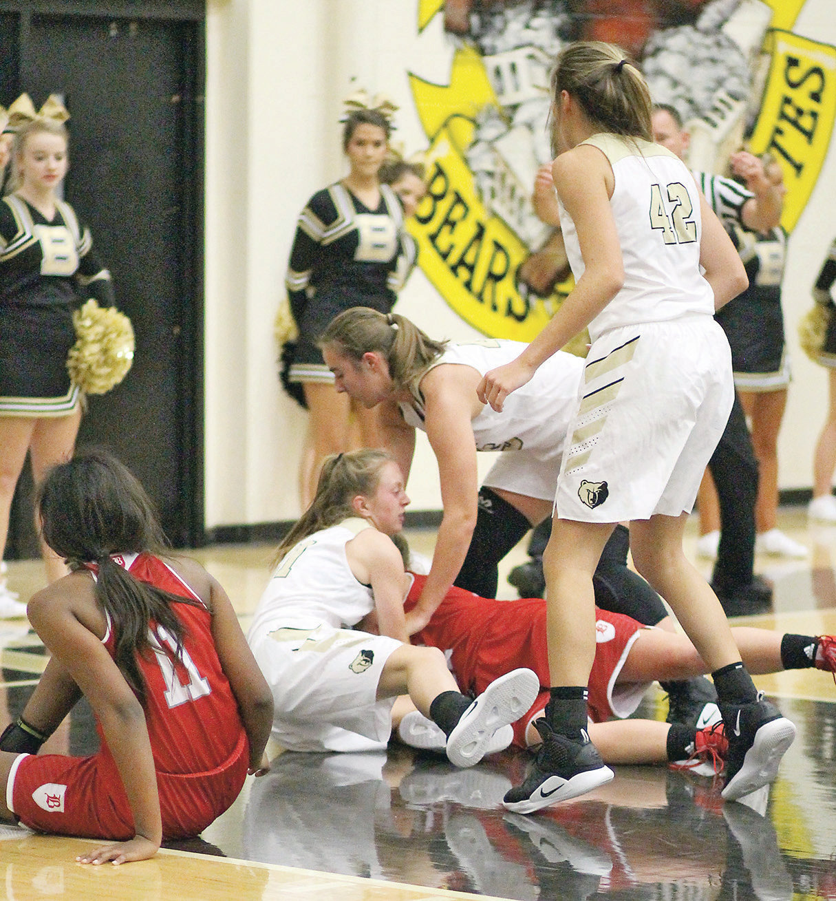 BRADLEY CENTRAL junior Cambree Mayo (21) battles for a loose ball with a Baylor player, while teammates Hannah Lombard (right) and Anna Walker (42) close in in Tuesday's season-opening victory at Jim Smiddy Arena.