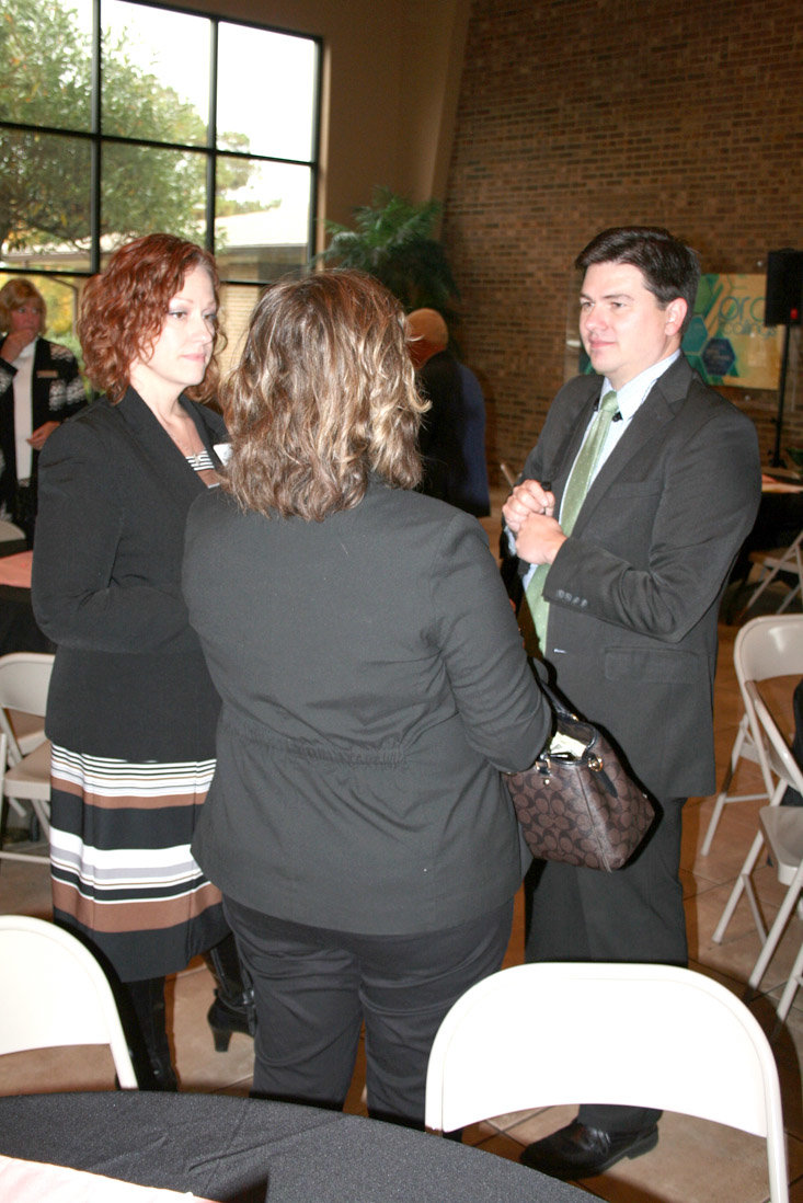 ADF ATTORNEY Matt Sharp chats with Traci Shellhouse and Beth Henderson of New Hope Pregnancy Care Center following his discussion of censorship of faith-based values. One instance that resonates with New Hope is a new California law that required pro-life birth centers to provide abortion information to expecting parents along with the pro-life literature.