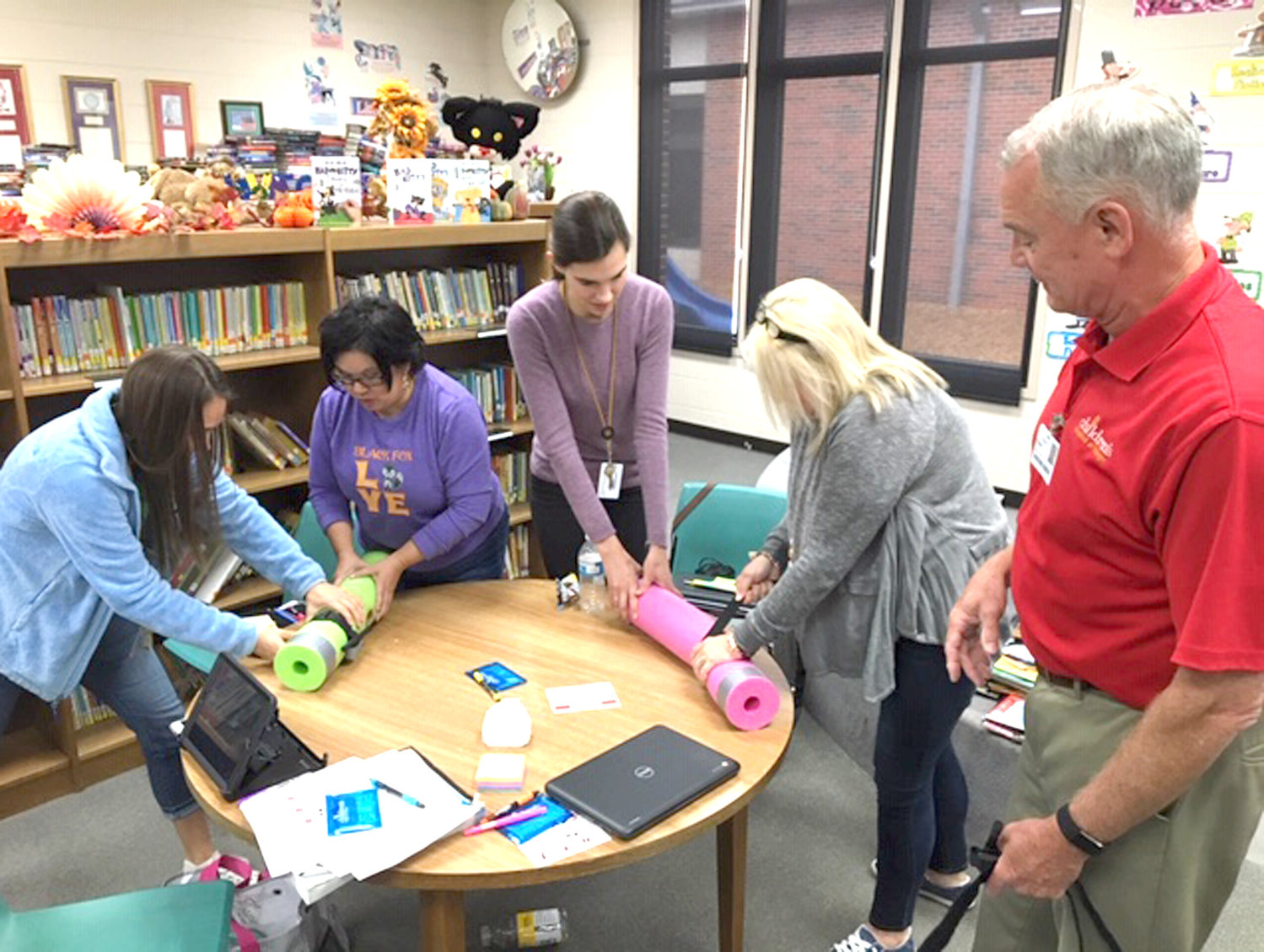 Black Fox Elementary teachers worked with nurse Valerie Lamon and Safety Educators Donna McBride and Robert Ward to provide valuable first aid training. Robert Ward supervises first-grade teachers Naomi Dycus, Janni Samples, Tori Willcutt and Sandy West in proper tourniquet procedures.
