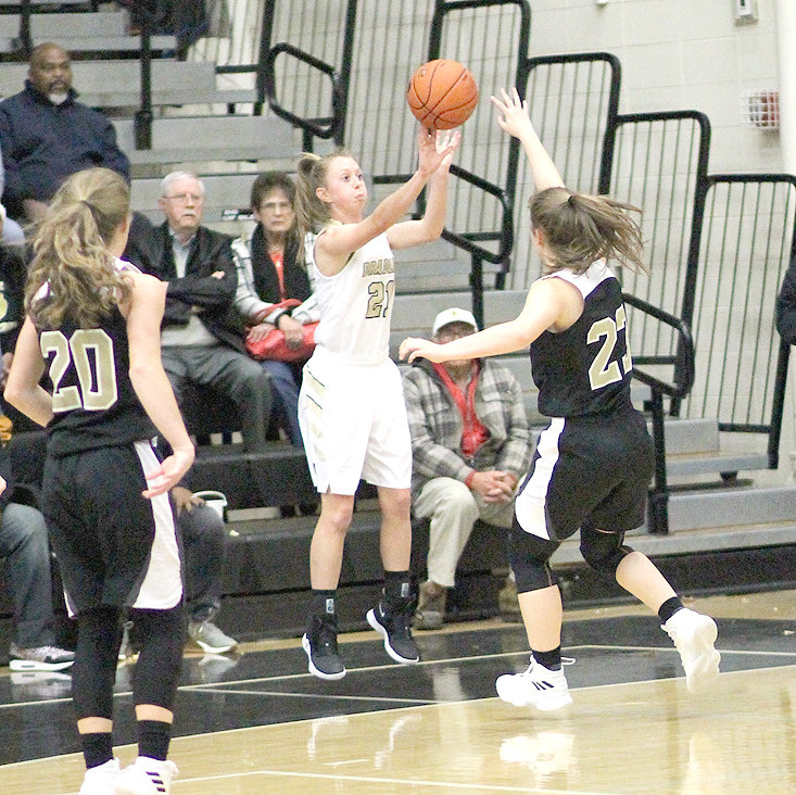BRADLEY CENTRAL junior Cambree Mayo (21) fires up one of her trio of successful 3-pointers in the 65-55 Bearette victory over Stone Memorial at Jim Smiddy Arena Tuesday evening.