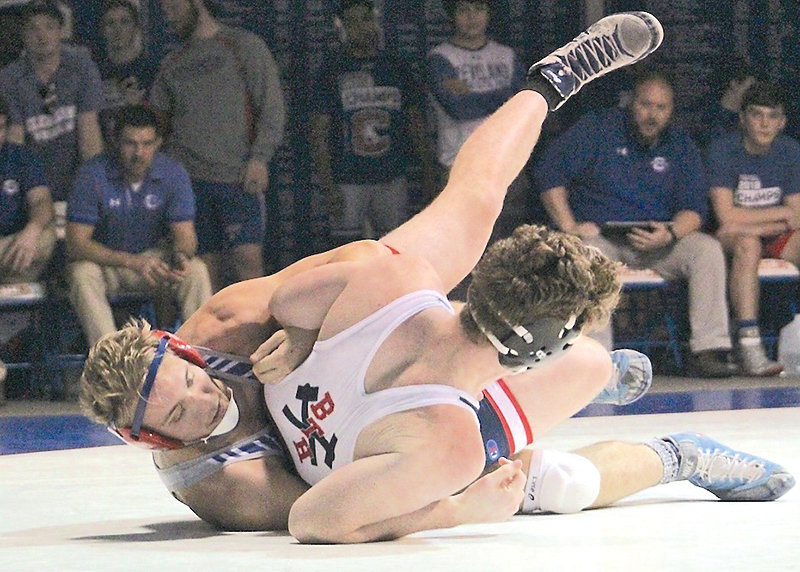 SECOND-RANKED senior wrestler Dylan Jones (back) helped Cleveland dominate in a matchup between the state's top two Class AAA teams Saturday, in Tullahoma.