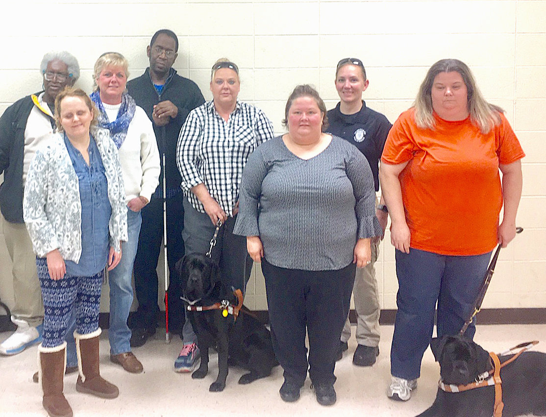 THE SOUTH EAST Chapter of the National Federation of the blind hear from guest speaker Officer Jennifer Samples about self-defense at its November meeting. From left are: Faheem Bengazi, vice president; Mandy Dixon; Jill Taylor; Jackie Holmes; Sharon Warren, social media with guide dog, Miss A; Shannon Huffman, vocational rehabilitation counselor; Officer Jennifer Samples, guest speaker; and Christy O'Dell, president with guide dog, Wiggles.