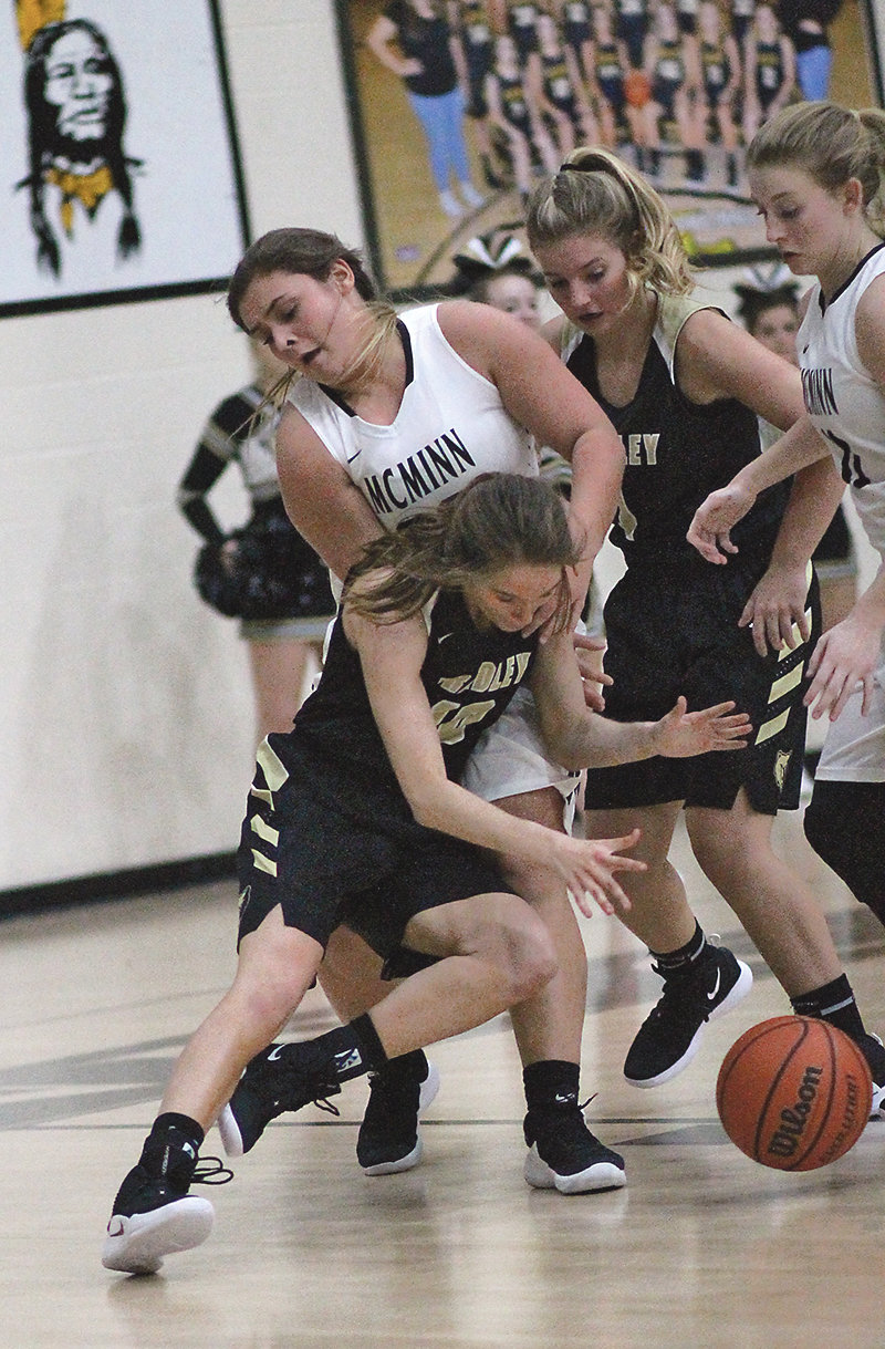 BRADLEY CENTRAL senior Anna Roberts (10) collides with a McMinn County defender during Tuesday evening's action in Athens. Roberts was perfect from the field and free-throw line for a career-high 18 points in the 53-39 Bearette victory.