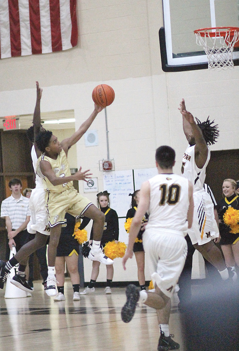 BRADLEY CENTRAL junior Antonnio Whaley (15) goes to the hoop for two of his 10 points in Tuesday's 68-52 District 5-AAA opening Bear victory at McMinn County.