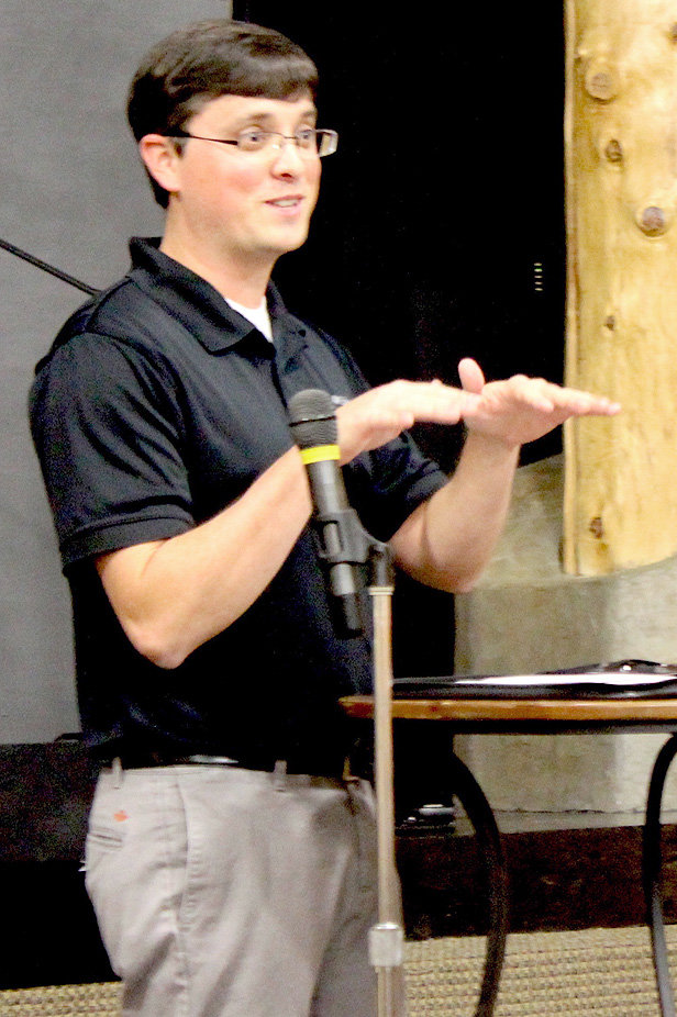 AREA RESIDENT Chris Berry discusses future rezoning by Cleveland City Schools during a parent gathering Monday night.