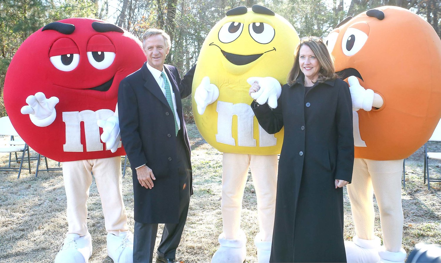 GOV. BILL HASLAM, left, and Tennessee's first lady, Crissy Haslam, right, pose for a photo with the M&M's character mascots at Tuesday's groundbreaking ceremony.