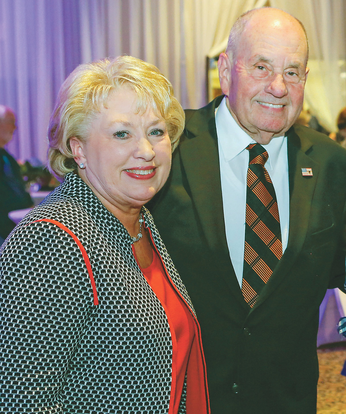 CLEVELAND MAYOR Tom Rowland and first lady Sandra, left, pose for a quick photo at a reception held in his honor at the Museum Center in August. The two-hour event drew a huge crowd of friends and supporters who were offering their best wishes in the Cleveland mayor's retirement from public office.