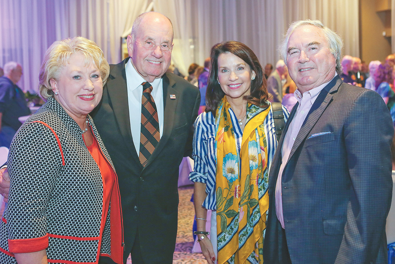 MAYOR TOM ROWLAND, and Cleveland's first lady Sandra Rowland, left, pose for a photo with Amy Banks and retiring City Councilman-At-Large Richard Banks at a reception held for the mayor at the Museum Center in August.