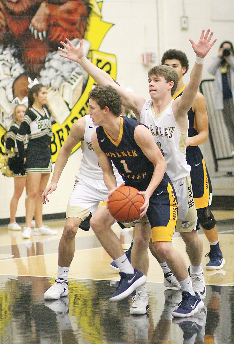 WALKER VALLEY senior Jordan Munck (1) will lead the Mustangs against county rival Bradley Central with Ashton Boyd (4) and Saylor Clark (back) trying to slow down the Herd's hot 15-1 start.