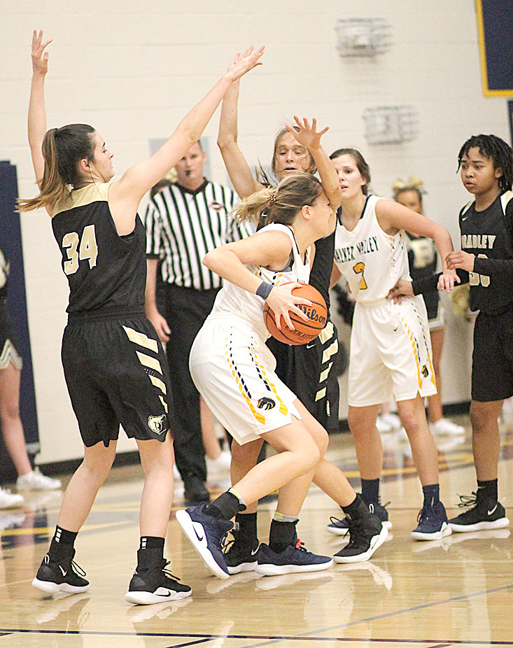 "BRADLEY CENTRAL senior Anna Roberts (back) and junior Alexis Barnes (34) put the defensive pressure on Walker Valley's Madison Rue (21), while Bearette Jamaryn Blair (33) and Lady Mustang Keyndall Gibson look on Friday evening at ""The Stable."""