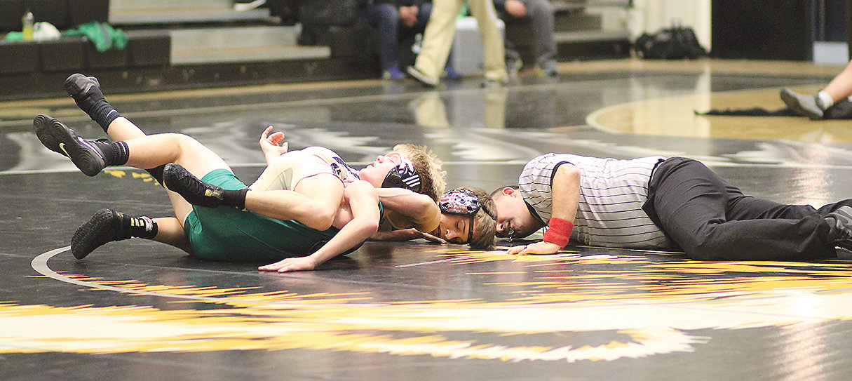 BEARS WRESTLER Ethan Wilson, center, battled to a first-period pin over East Hamilton's Davis Clark, in the 106-pound match in Smiddy Arena Tuesday, at Bradley Central.