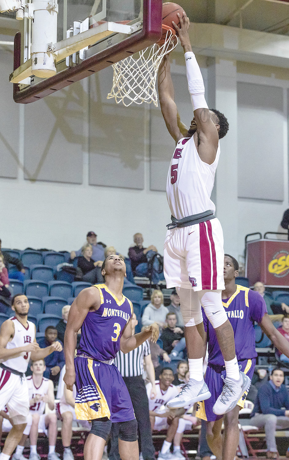 LEE JUNIOR forward Ryan Montgomery slams home a dunk in Thursday's win over Montevallo.