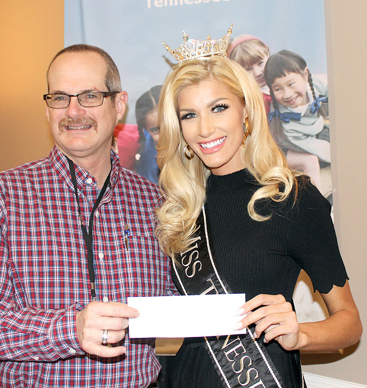 CLEVELAND KIWANIS President Ramon Torres, left, presented a donation to Miss Tennessee Christine Williams from the club to the Children's Miracle Network Thursday at the Elks Lodge in downtown Cleveland. Williamson was the luncheon's guest speaker.