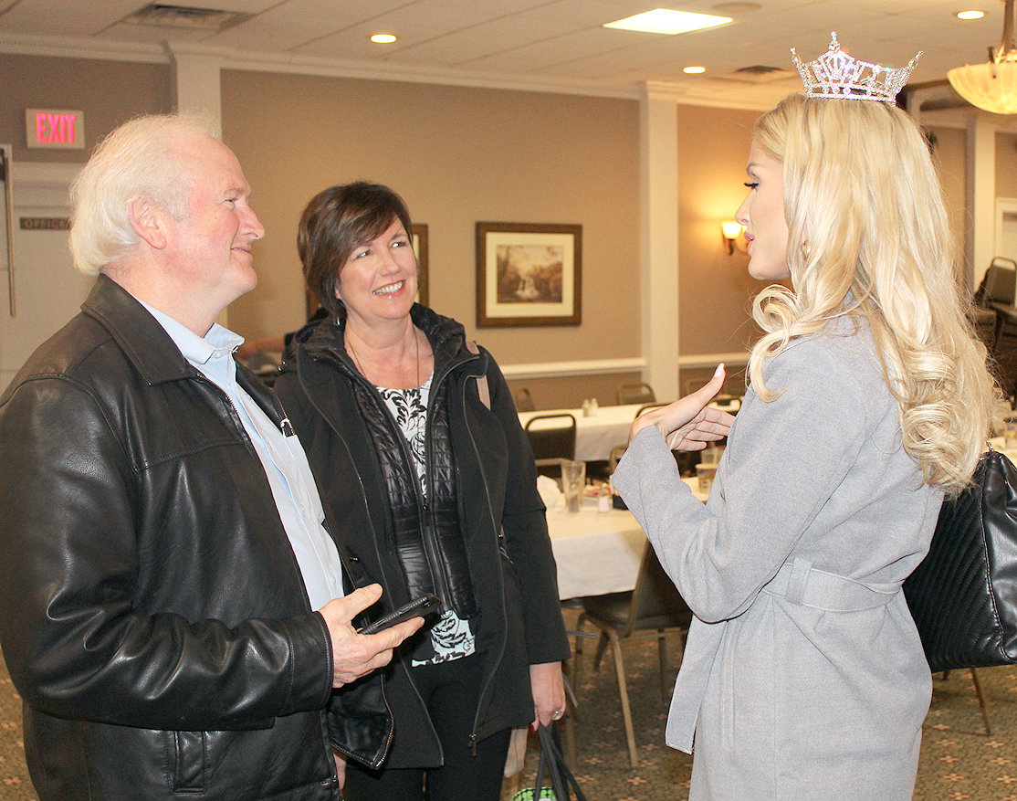 MISS TENNESSEE, Christine Williamson, right, chats with Jim Lane, left, and Traci Hamilton, center, following this week's Cleveland Kiwanis Club luncheon at the Elks Lodge. As Miss Tennessee, Williamson is the governor's spokesperson for Character Education, and also serves as an ambassador for the Alzheimer's Association, and a spokesperson for the Children's Miracle Network.
