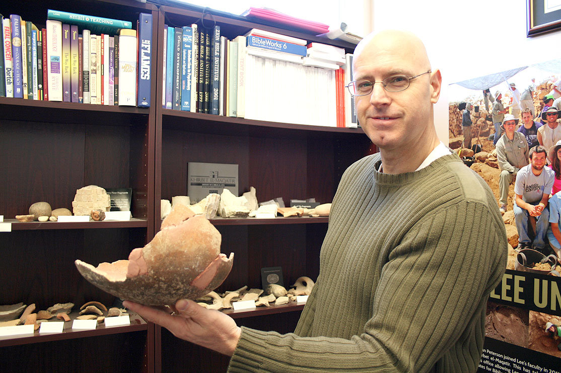 DR. BRIAN PETERSON holds up some of the pottery he's found in Israel. While it might be seen as a fragile artifact in America, the pottery is viewed as common scraps in Israel, and often discarded due to its abundance in the history-rich city.