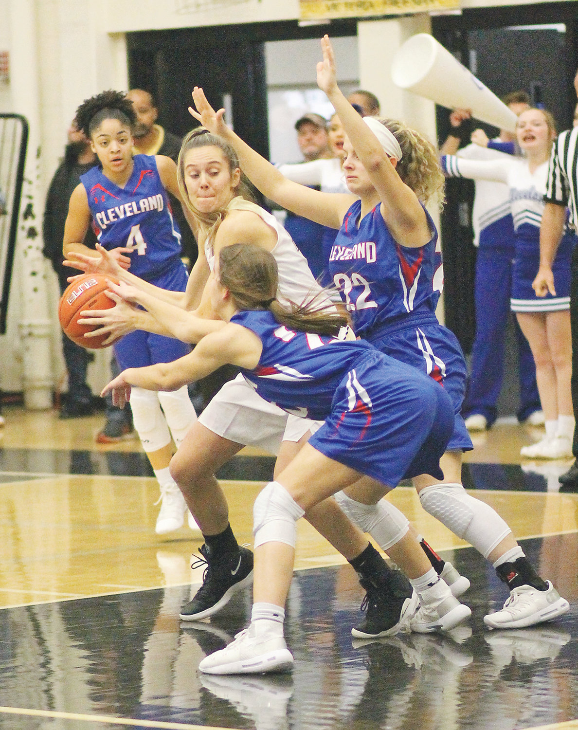BRADLEY CENTRAL junior Anna Walker (centeR) is triple-teamed by Cleveland's Kara Williams (front), Joy Douglass (22) and Mariyah Person (4) but is able to get a pass off to a teammate during Monday evening's action at Jim Smiddy Arena.
