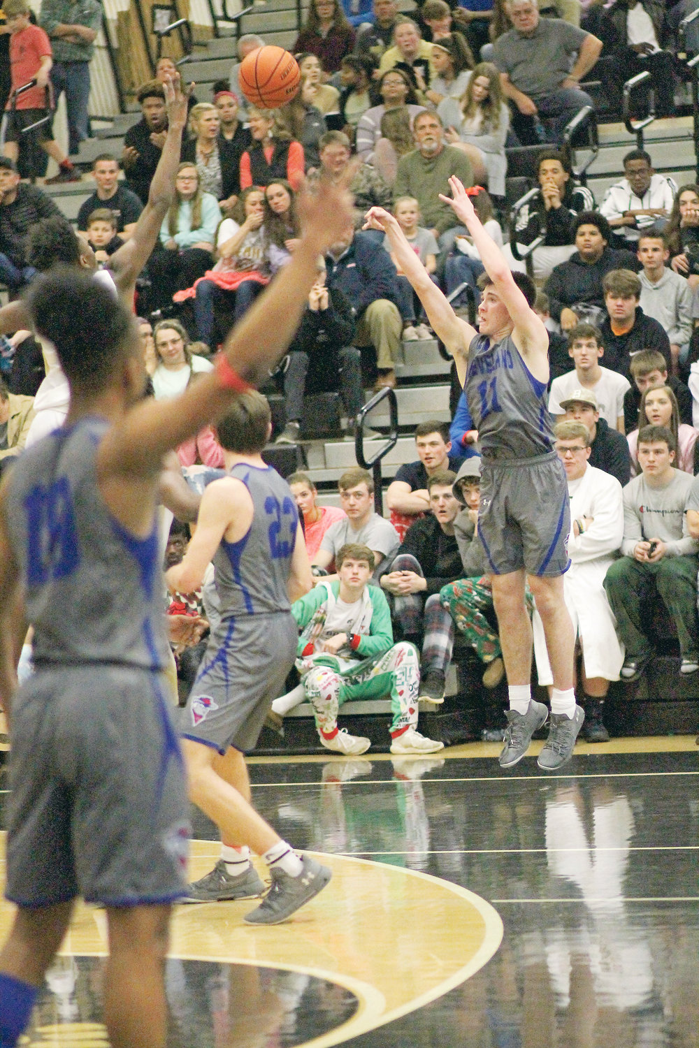 CLEVELAND HIGH sophomore Grant Hurst (11) fires one of his half dozen 3-pointers in Monday evening's 71-60 Blue Raider victory over Bradley Central at Jim Smiddy Arena.