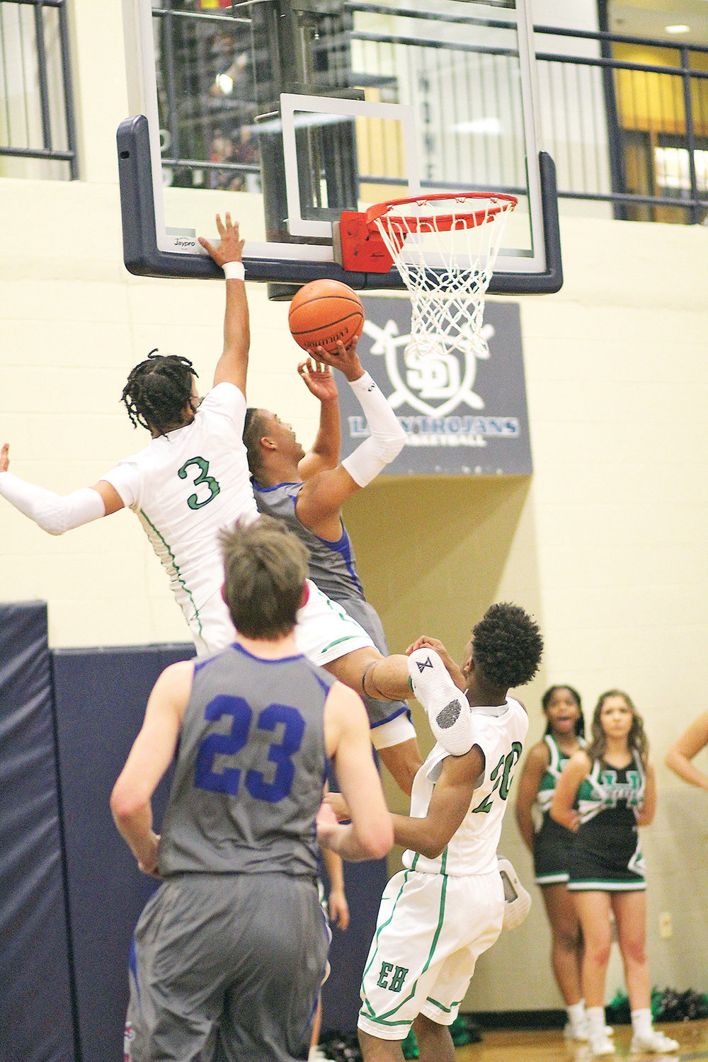 CLEVELAND BLUE RAIDER guard JaCobi Wood puts up a shot in front of East Hamilton's Morrell Schramm in the first quarter of the district 5-AAA championship game Tuesday, at Soddy-Daisy High School.