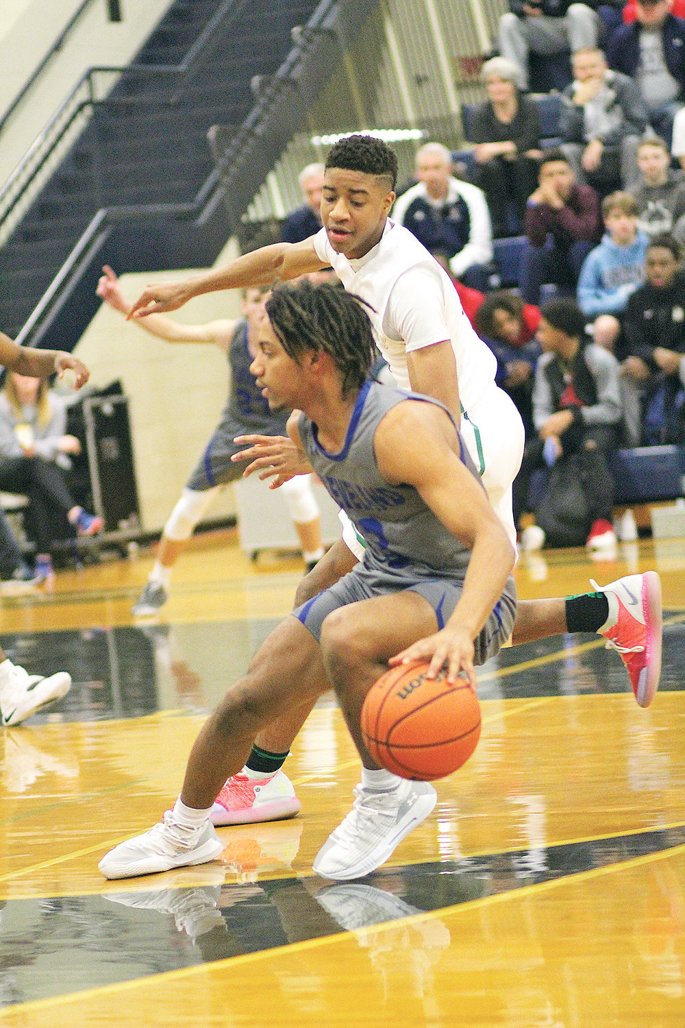 CLEVELAND'S Isaiah Johnson pulls up in the lane in front of an East Hamilton defender in the first half of the District 5-AAA championship game Tuesday, at Soddy-Daisy High School.