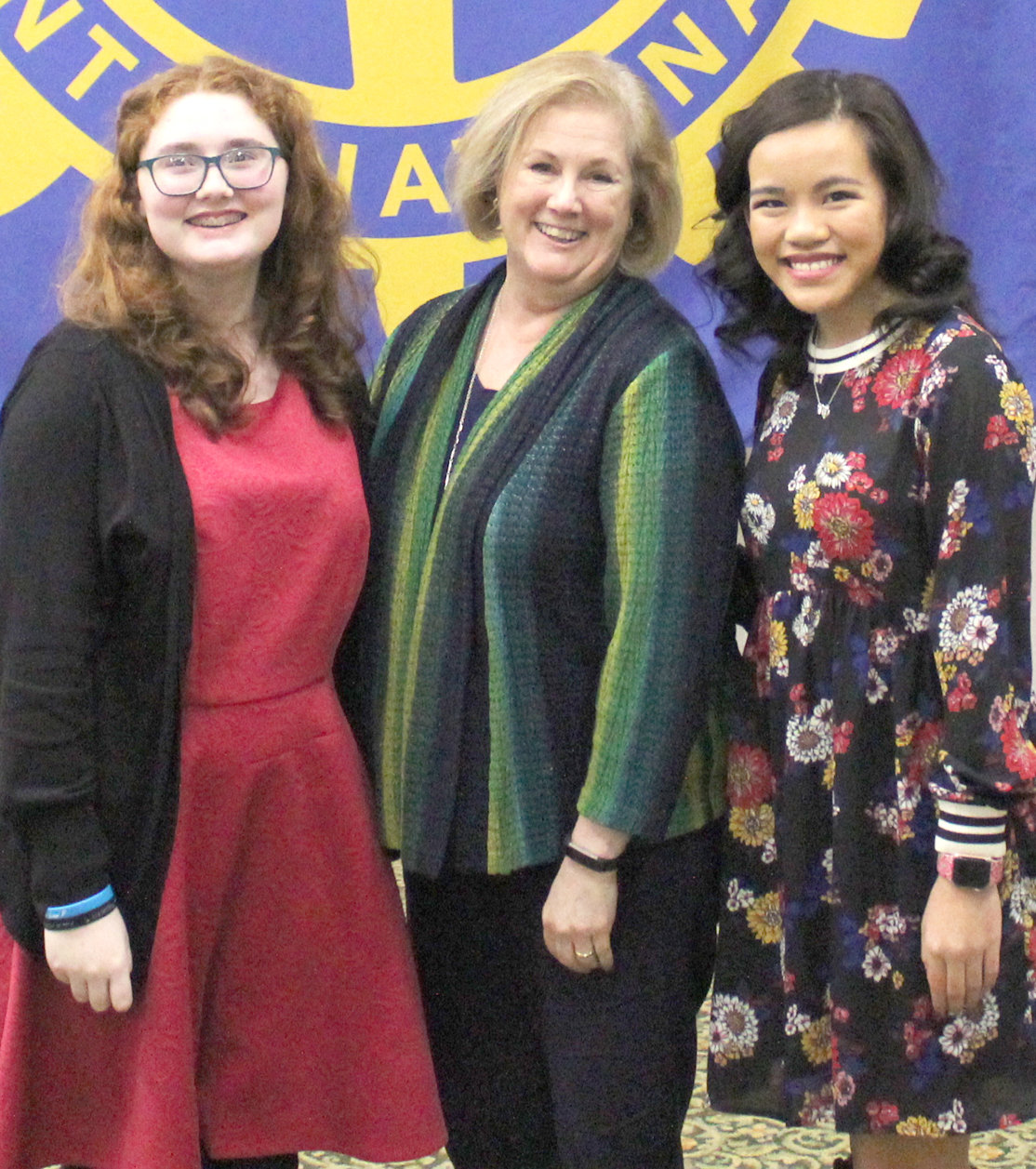 McKENZIE MANCINI, left, and Lily Bradney, right, pose with Rotary Club of Cleveland's Denise King shortly after they each delivered a speech during the club's weekly luncheon, held Tuesday at the Museum Center.