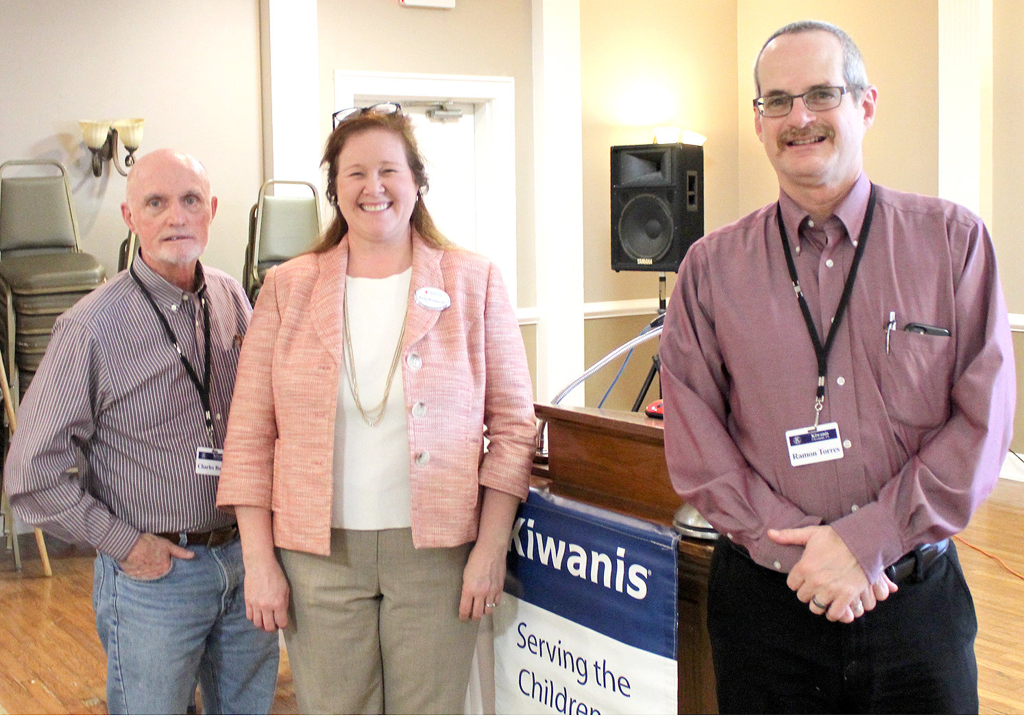 KELLY BROWAND, center, a community volunteer for the American Red Cross, was the guest speaker at last week's Cleveland Kiwanis Club luncheon at the Elks Lodge downtown. With Browand, after the program, are Program Chairman Charles Bagley, left, and Kiwanis President Ramon Torres.