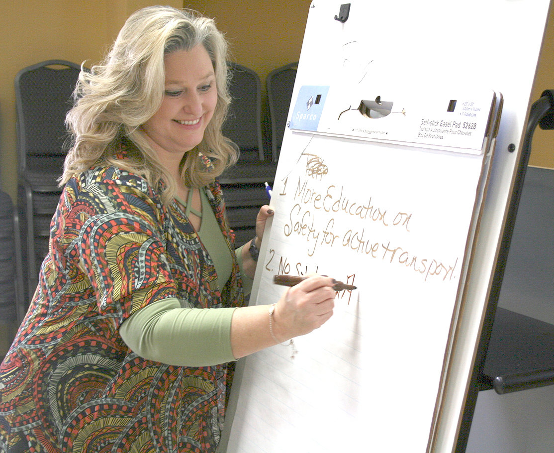 AMY DAVENPORT, health educator at the Bradley County Health Department, is pictured here writing out the different ways the Bradley County Health Council feels our county needs to improve in areas relating to healthcare.