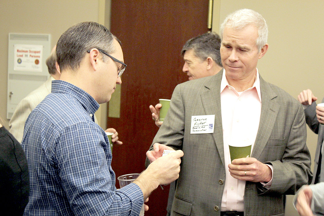 CBCC February 2019 Membership Coffee event attendees exchanged business contacts and conversations at the office, such as, from left, Nick Evenson, Forward Motion Films owner, and Cameron Fisher, Church of God International Offices communications coordinator.