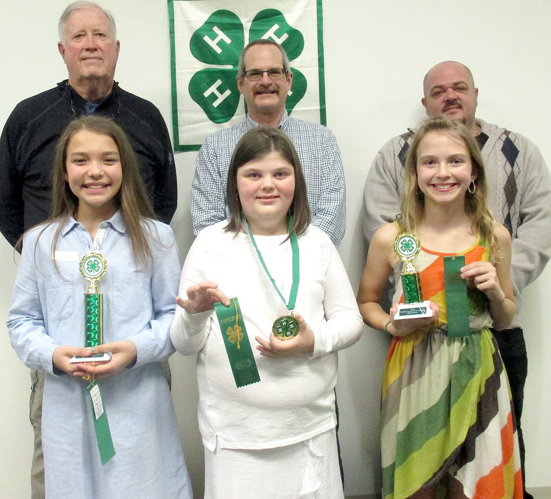 The Bradley County 4-H Public Speaking fifth-grade winners were, from left, Alivia Johnson, second place (Michigan Avenue School); Amelia DeBord, first place (Charleston School); and Chloe Ryerson, third place (Black Fox School) with judges, back, Hugh Walker, Ramon Torres and John Catalfamo, all members of the Kiwanis Club of Cleveland. First-place winners will advance to the Southeastern Corner Speech Contest March 14 in Rhea County.